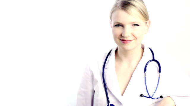 Close-up of a female doctor smiling with stethoscope.