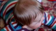 Close-up of a happy smiling baby looking at camera