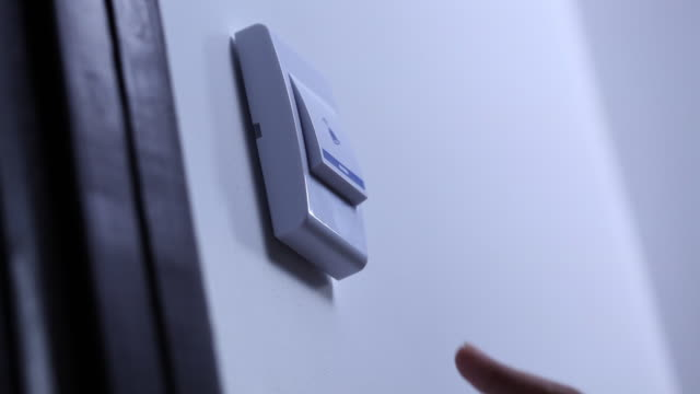 Close-up of a man ringing the doorbell