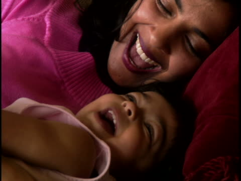 Close-up of a mother laughing with her daughter