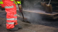 Closeup of a road being tarmacked