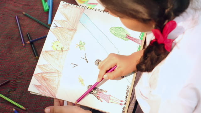 Close-up of a schoolgirl making a drawing