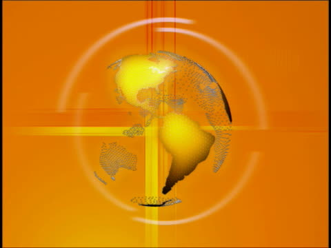Close-up of a spinning globe on an orange background