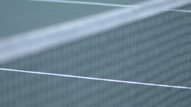 Close-up of a tennis net.