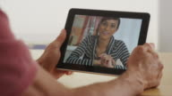Closeup of african woman talking on tablet