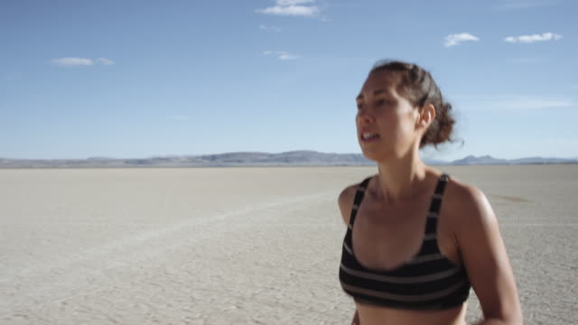 SLO MO: Close-up of an Attractive Woman Running in the Desert