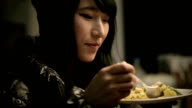 Close-up of Asian girl enjoying tasty and healthy food.
