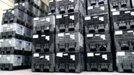 Close-up of black plastic crates in warehouse