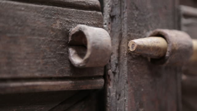 Close-up of bolt being unlocked