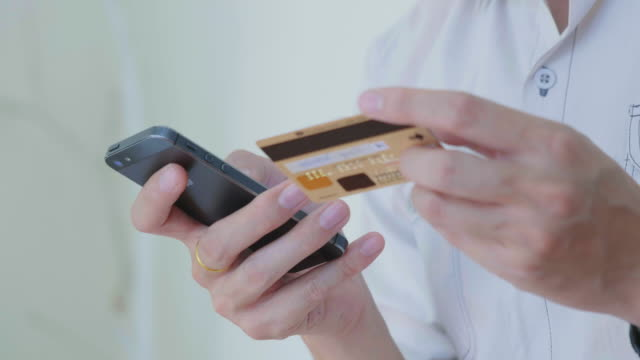 Close-up of Businessman shopping online on Mobile phone,Tilt down