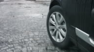 Close-Up Of Car Wheel Against Roud