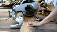closeup of circular saw for cut wood plank