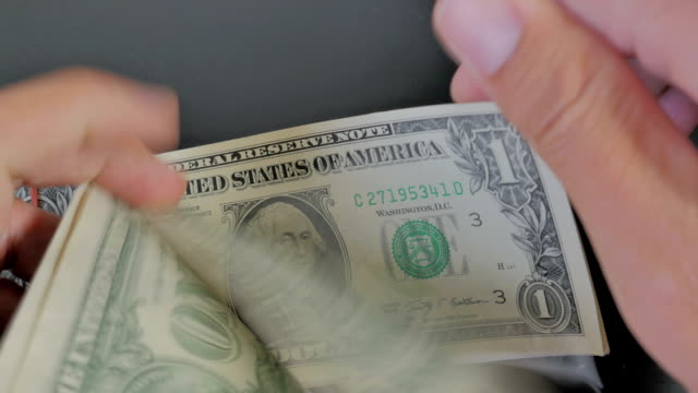 Close-up of Counting money Dollars Cash banknote