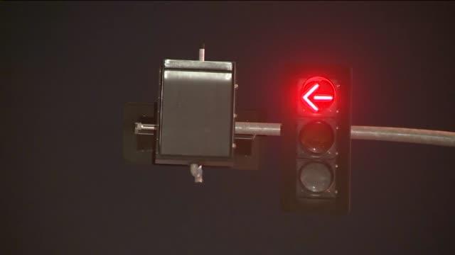 KTLA Closeup of digital train sign red light at night in Los Angeles