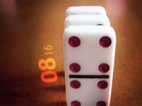Close-up of dominoes in motion
