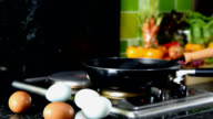 Closeup of eggs with kitchenware in modern kitchen / healthy lifestyle conceptual