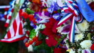 Close-up of flowers and flags with rack focus at the Korean War Veterans Memorial in Washington DC