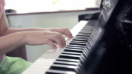 Close-up of girl playing the piano,Dolly shot