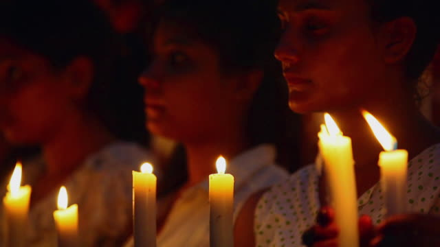 Close-up of group of Protestors holding candles, Delhi, India