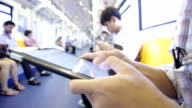 Close-up of Human Hand typing virtual keyboard on the train