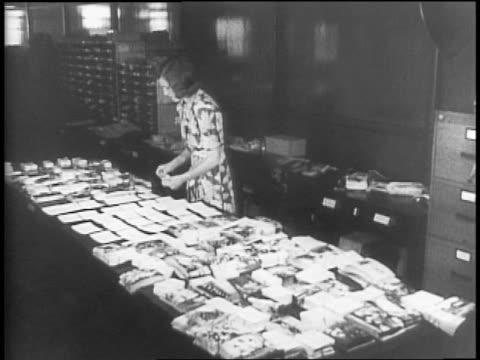 Closeup of Katherine Blackburne / exterior of US Information building / women working inside Information building / people around information desk /...