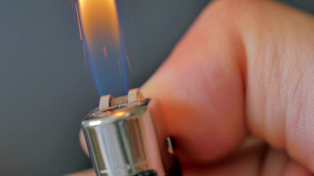 Close-up of lighter igniting on black background,Slow Motion