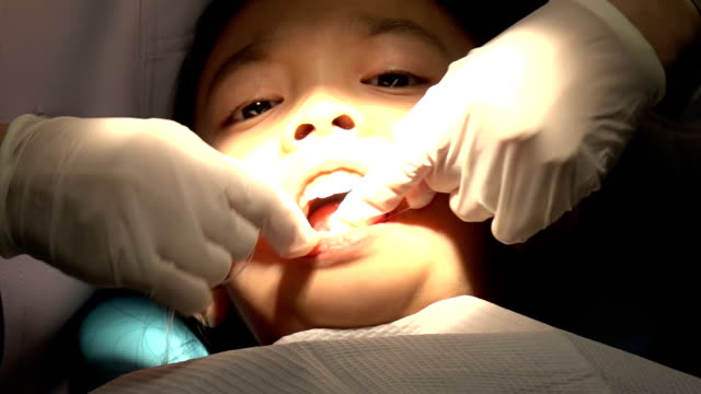 Closeup of little girl at dental clinic