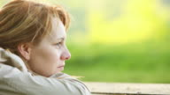 Close-up of lonely young woman in the park