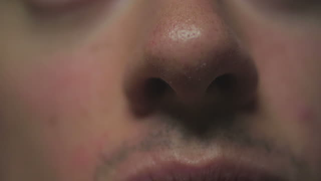 HD: Closeup of man's nose