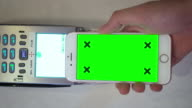 Close-up of Mobile/Contactless Payment,Green Screen