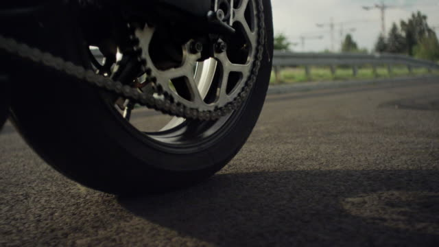 Closeup of motorcycle tire spinning on the road