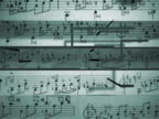 Close-up of musical notes on a sheet of paper