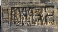 Close-up of relief panels of Borobudur temple in Central Java, Indonesia