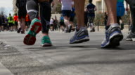 Close-up of running people during a race.