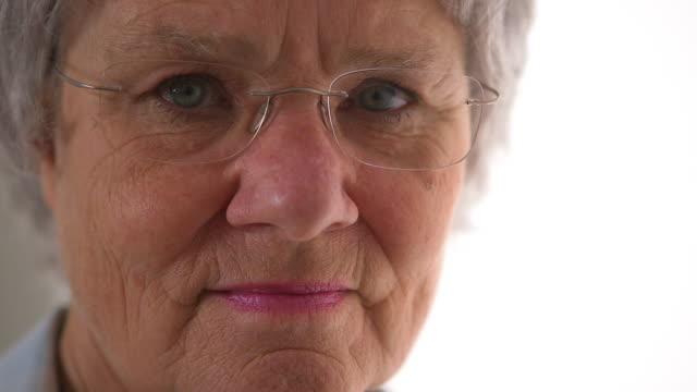 Closeup of senior woman looking at camera