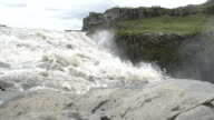 Close-up of the mighty  Dettifoss  waterfall  in Vatnajökull National Park, Iceland; People enjoying the natural phenomenon from above