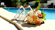 Close-up of the wedding bouquet and beautiful shoe.