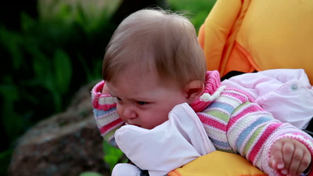 Close-up of unhappy baby rubbing the mosquito bite