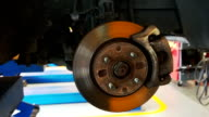 Close-up of unmounted brakes and suspension of a car