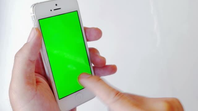 Nahaufnahme mit Handy, grünen Bildschirm