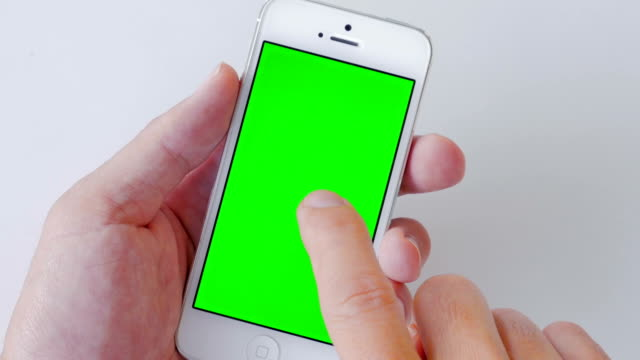 Close-up of Using smart phone,Green screen