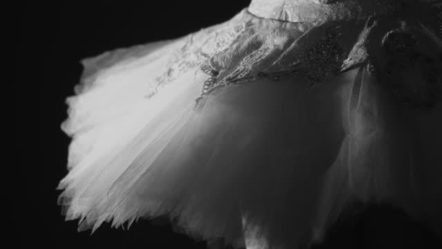 Closeup of woman jumping in tutu