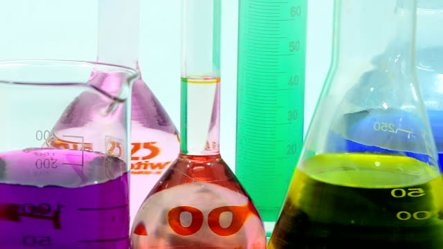 close-up panning : chemicals in different glassware