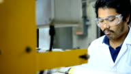 close-up panning: young engineer concentrate to make plastic bag fiilm