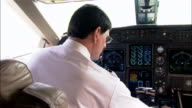 Close-up Pilot navigating control panel in cockpit of private airplane