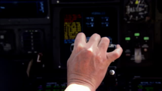 Close-up Pilot pushing throttle in cockpit of private airplane