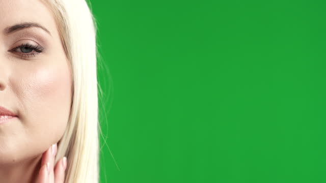 Close-up portrait of a young woman on green-screen
