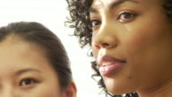 Closeup portrait of two business women talking in office