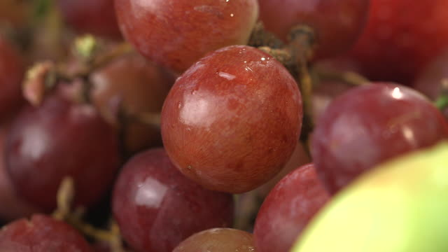 Close-up sequence showing a red bunch of grapes.