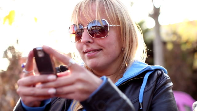 Close-up shot of a woman using smartphone